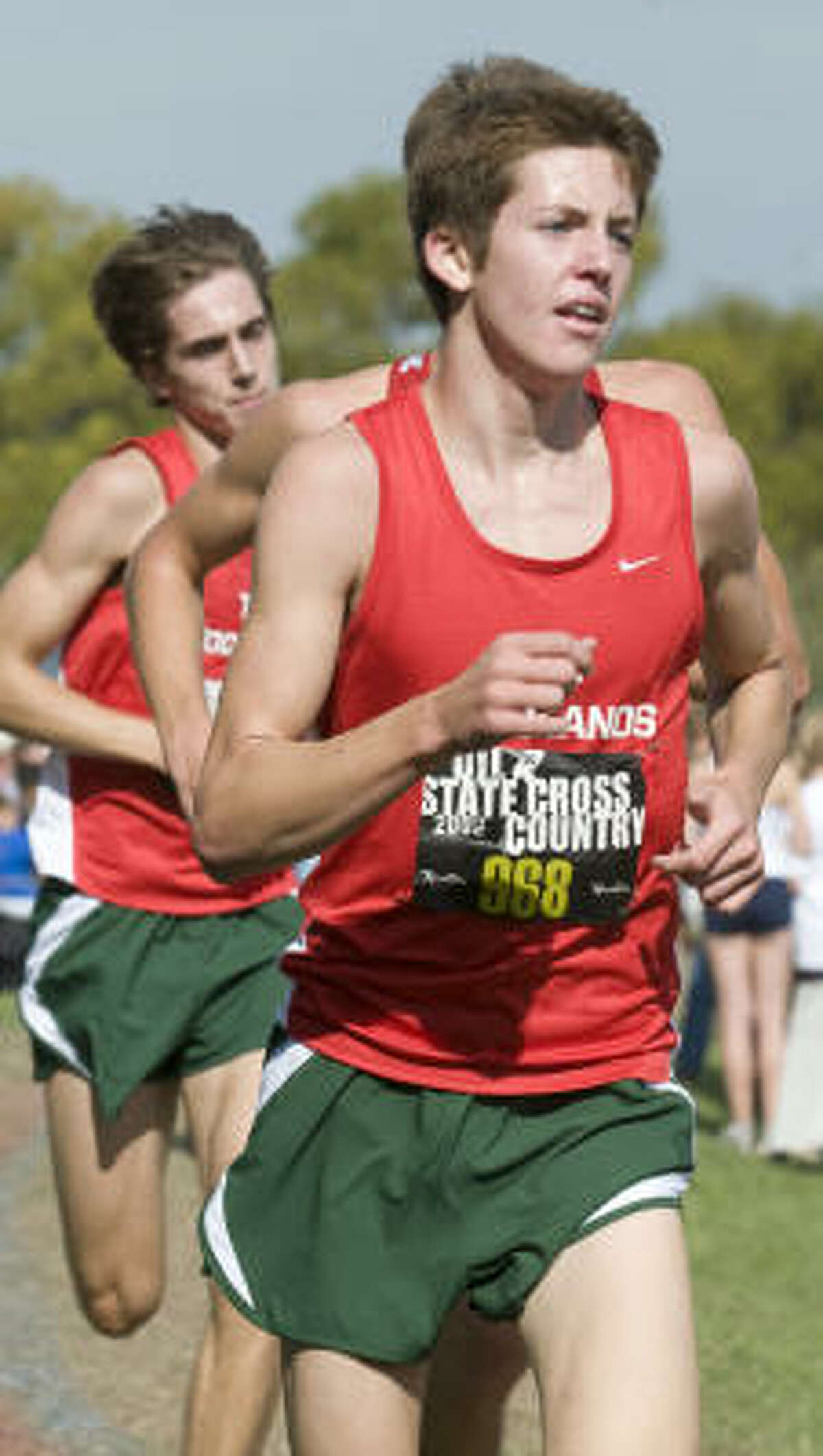 Tyler Bradley, a senior at The Woodlands, is shown during the Boys 5A race.