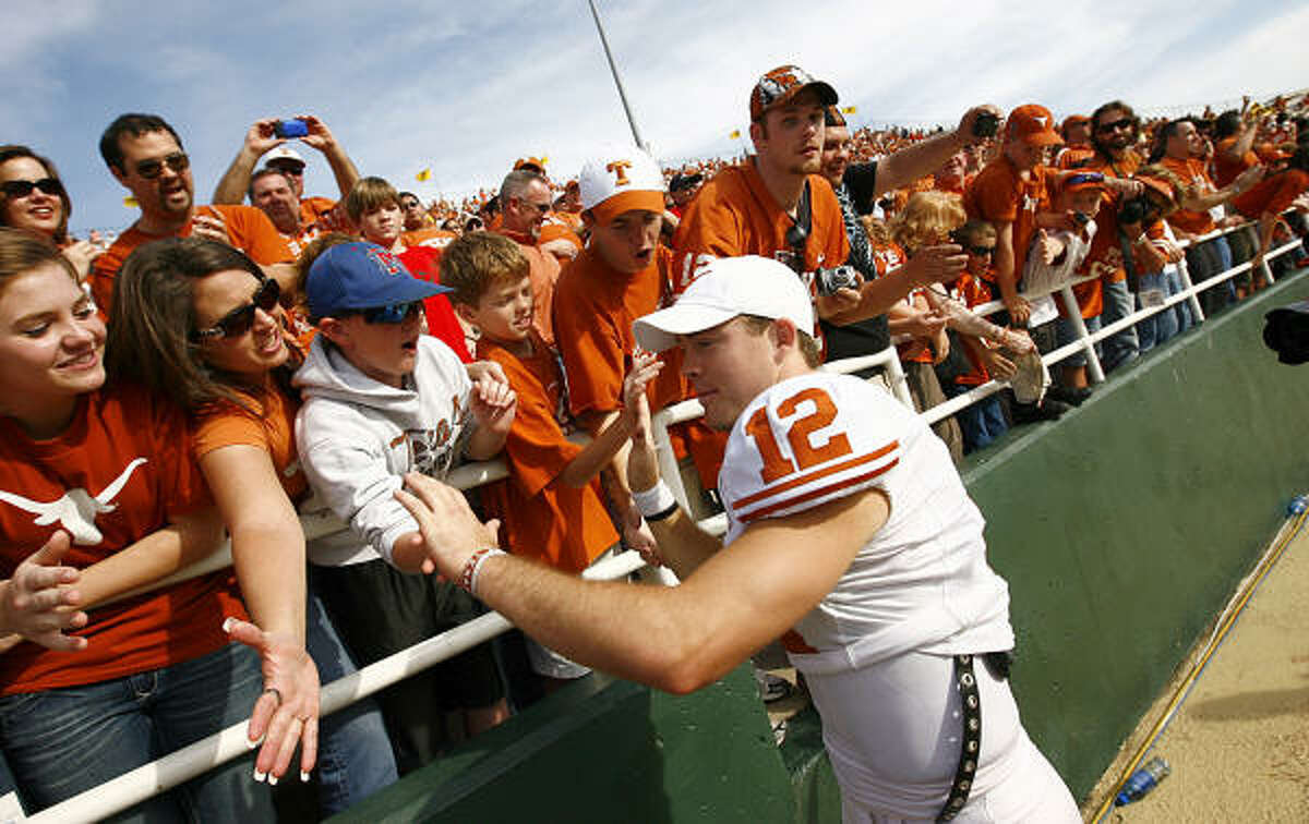 Texas quarterback Colt McCoy celebrates with fans after beating the victory against Baylor in Waco.