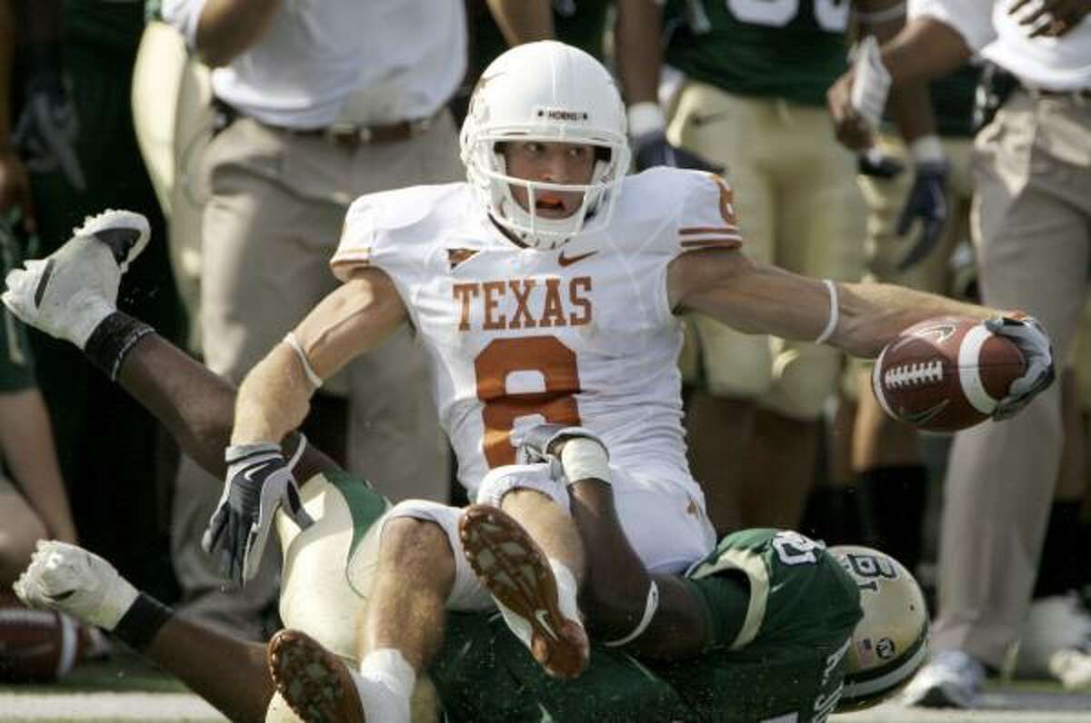 Texas wide receiver Jordan Shipley is brought down by Baylor cornerback Darius Jones after making a reception in the second half.
