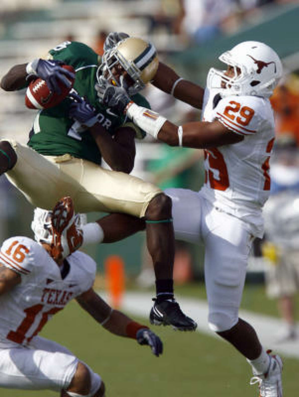 Baylor receiver Kendall Wright pulls in a pass against Texas defensive back Clark Ford.