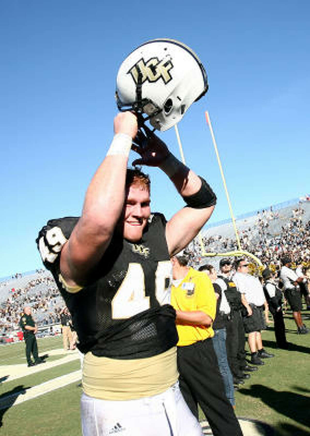 Central Florida's Bruce Miller celebrates after the victory against the University of Houston on Saturday in Orlando, Fla.