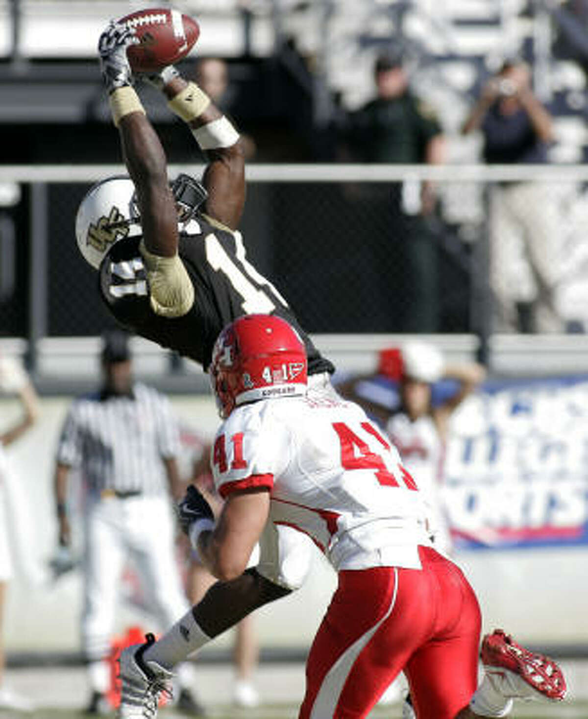 Central Florida receiver Quincy McDuffie grabs a touchdown catch over UH safety Nick Saenz.