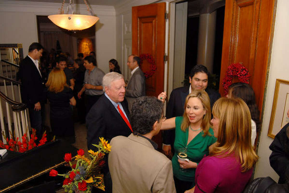 Guests including Franci Crane and Rich and Nancy Kinder chat at the party.