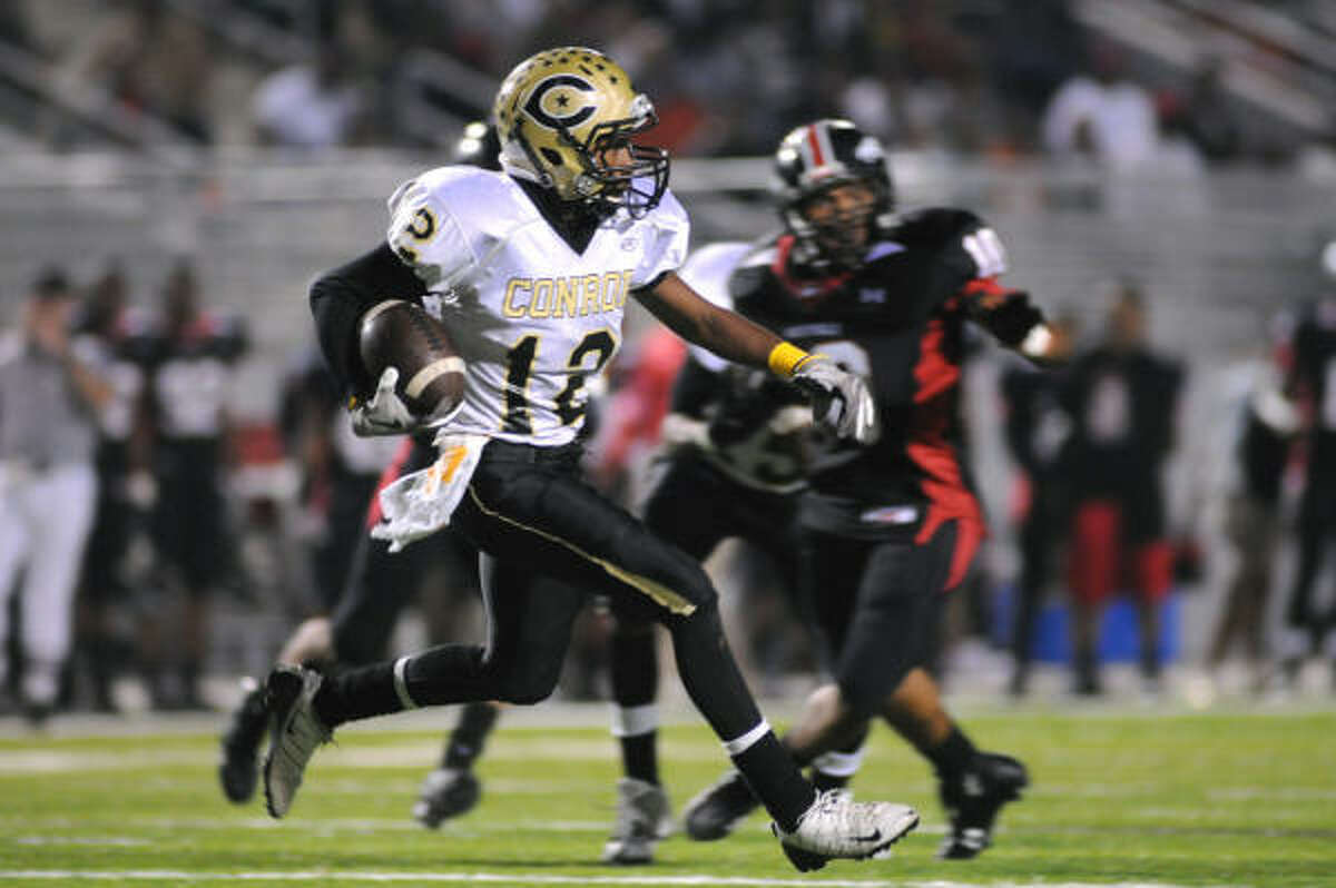 WESTFIELD 42, CONROE 7: Conroe senior wide receiver Desmond Jones looks for yardage during the Tiger's playoff game versus the Westfield Mustangs.