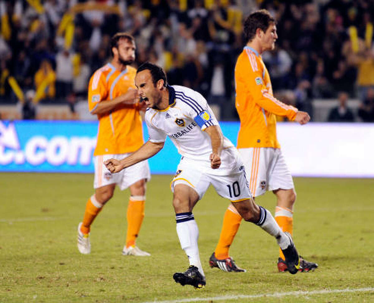 Los Angeles' Landon Donovan, center, celebrates his goal on a penalty kick during the first half.