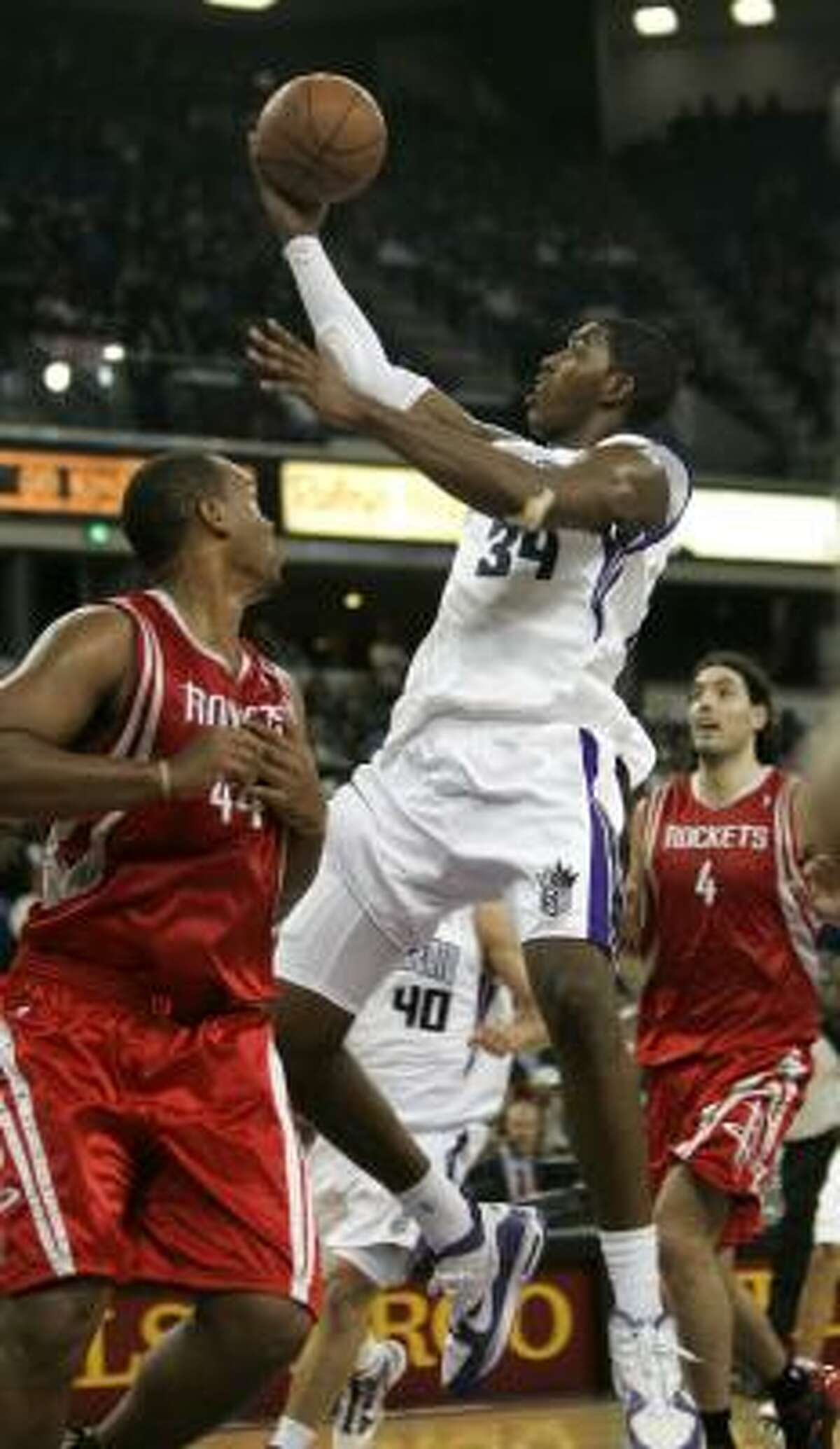 The Rockets struggled to contain Sacramento forward Jason Thompson, center, who had 27 points and 11 rebounds in the Kings' 109-110 win on Friday night in Sacramento, Calif.