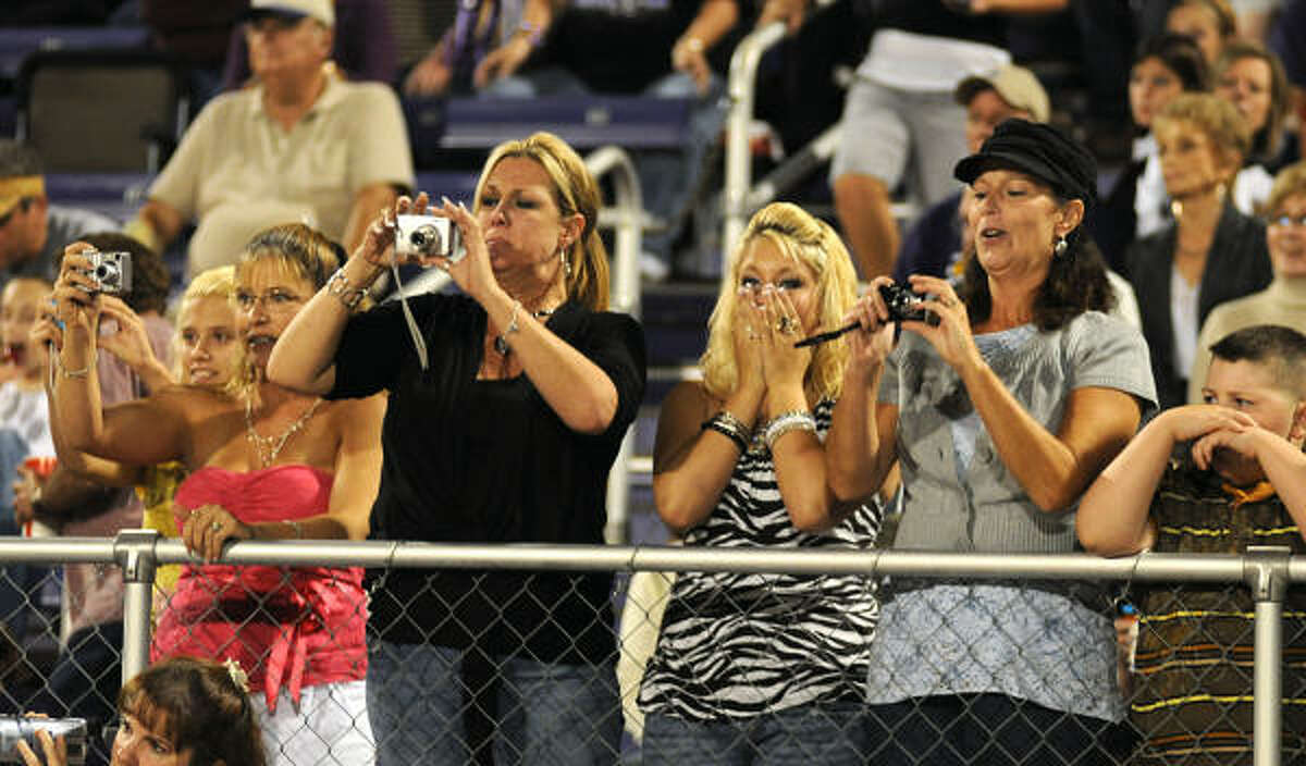 Montgomery fans take pictures of the homecoming court.