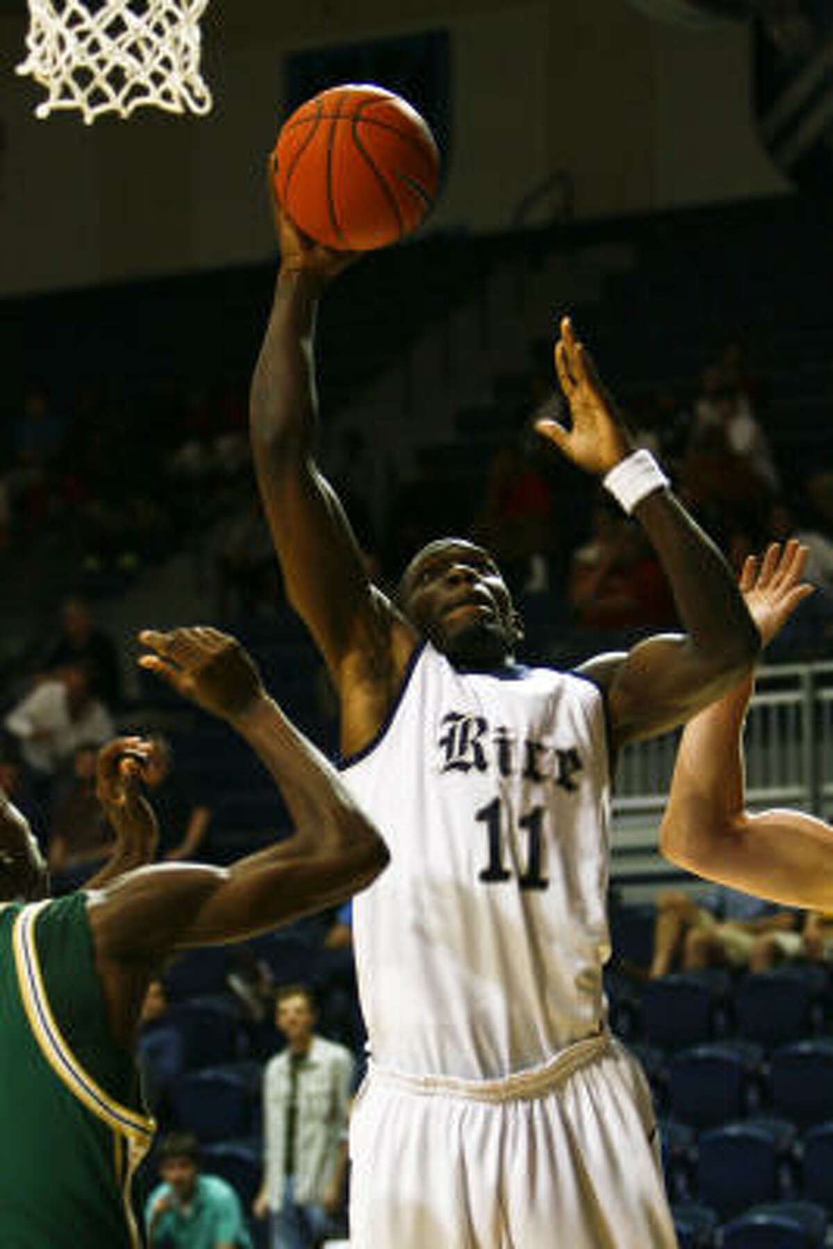 Rice's Suleiman Braimoh (11) pulls down a rebound during the first half of Friday's season opener against Sacramento State at Tudor Fieldhouse. Rice won 81-51.