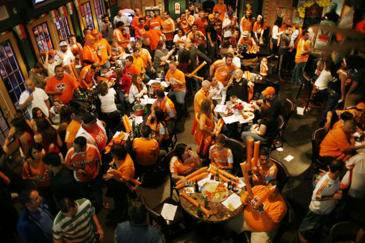 Fans in Houston watch as the Dynamo face the Los Angeles Galaxy for the right to advance to the MLS championship game. The team hosted a watch party at Lucky's.