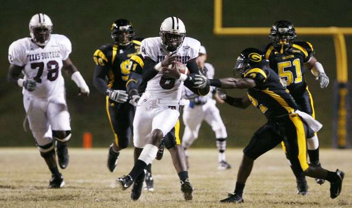 Texas Southern quarterback Arvell Nelson (8) threw for two touchdowns and rushed for another, but it wasn't enough to prevent Grambling from escaping with a 47-33 win Thursday night in Grambling, La.
