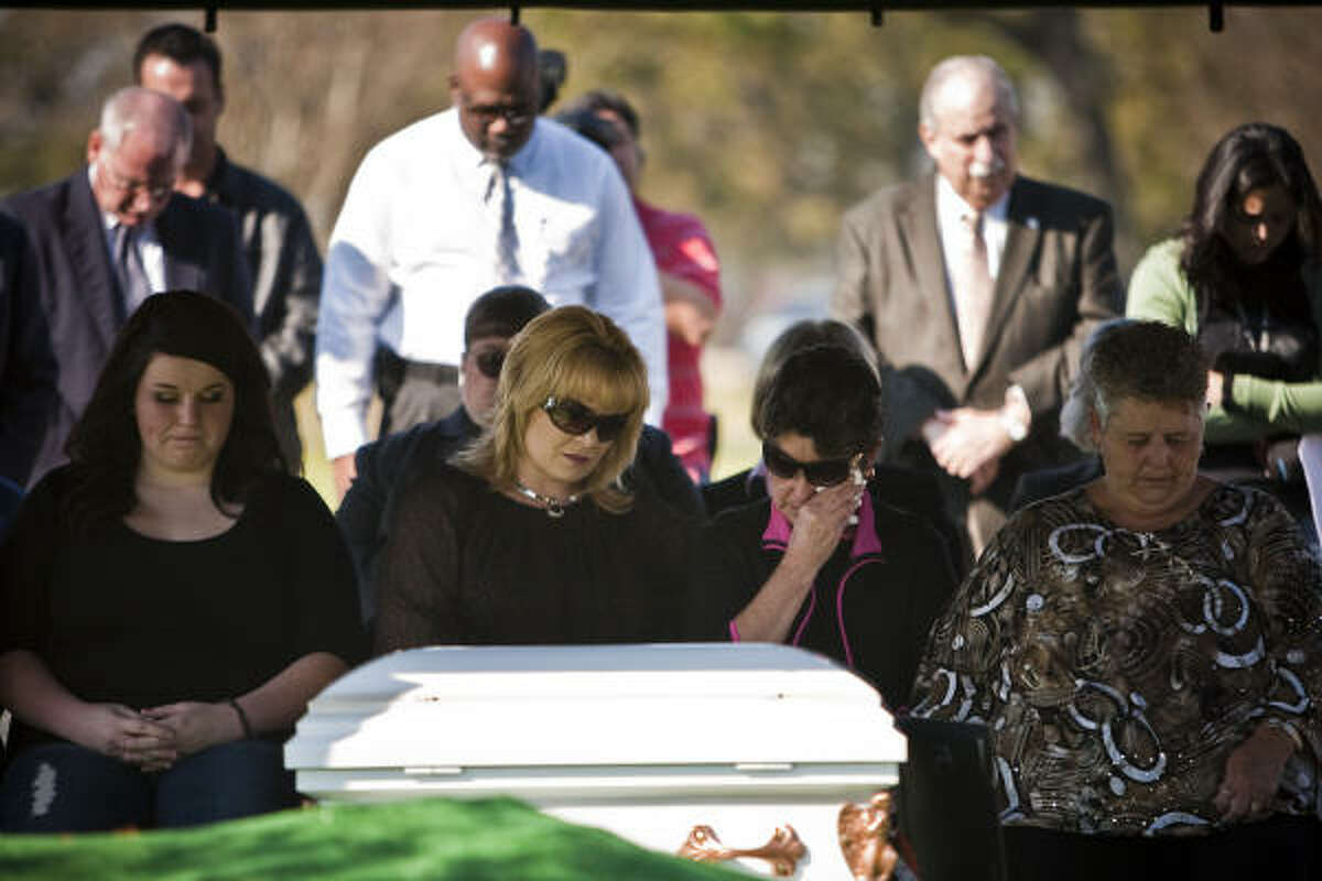 Audrey LaJaunie, Kim Gomez, Cindi Michalk and Shirley Lyles mourn at the service. Mourners included relatives of another suspected Corll victim, Joseph Lyles.