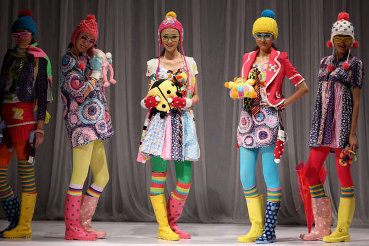 Models wear creations from a young Chinese designer during China Fashion Week in Beijing. The bi-annual fashion extravaganza showcases China's fashion houses and their latest collections to buyers all over the world.