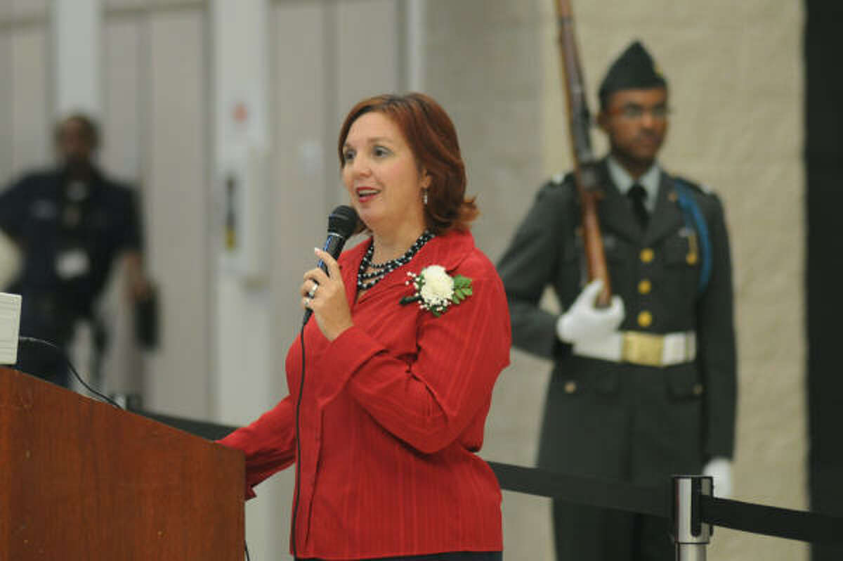 Stacey Hamlet, Smaller Learning Community Coordinator at Humble High School, speaks during the Veteran's Day program at Humble High.