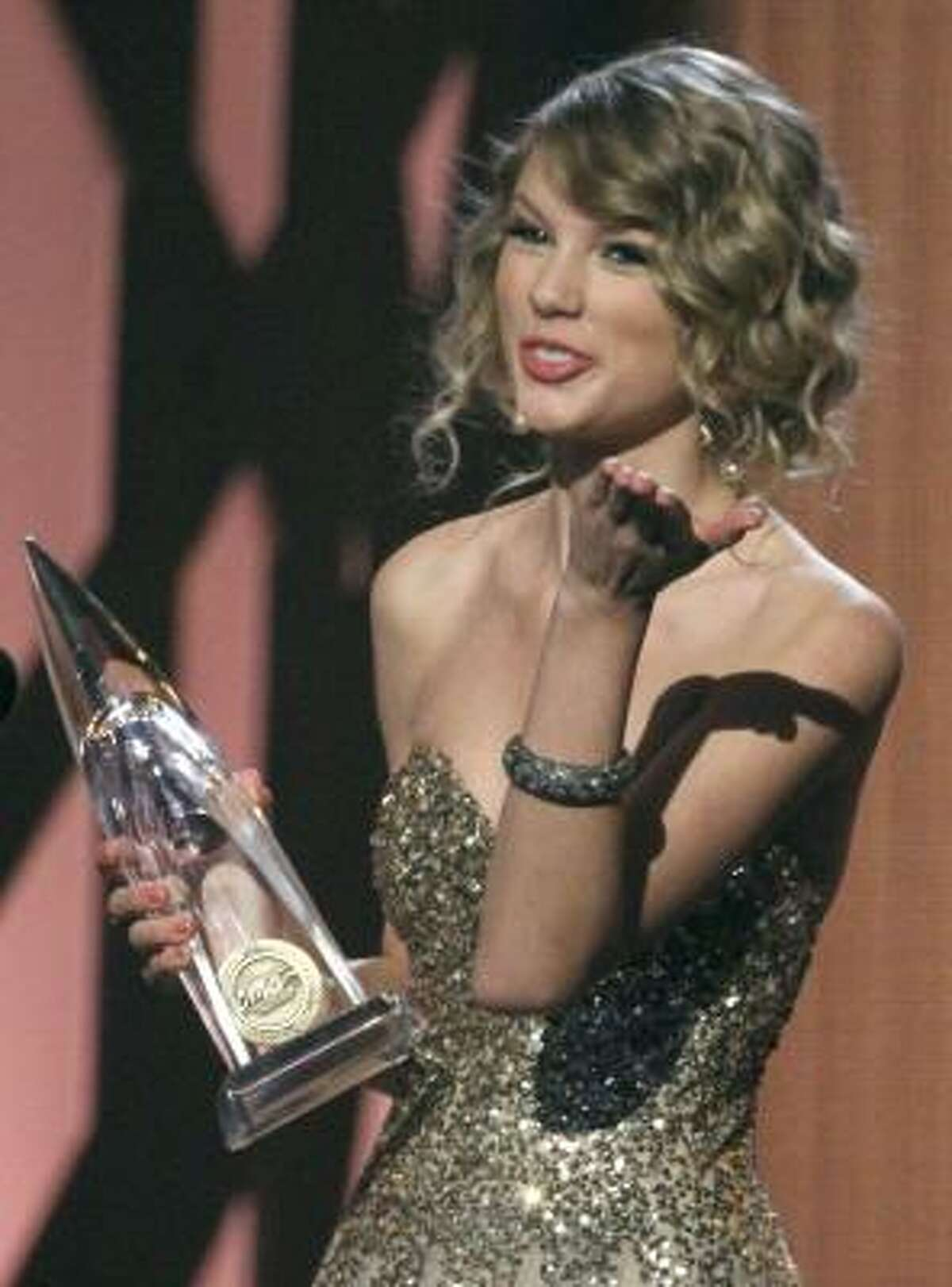 Taylor Swift accepts the award for Female Vocalist of the Year.