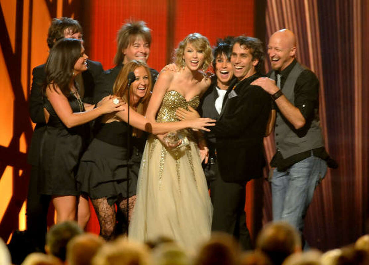 Musician Taylor Swift calls up her band after accepting the award for Entertainer of the Year.