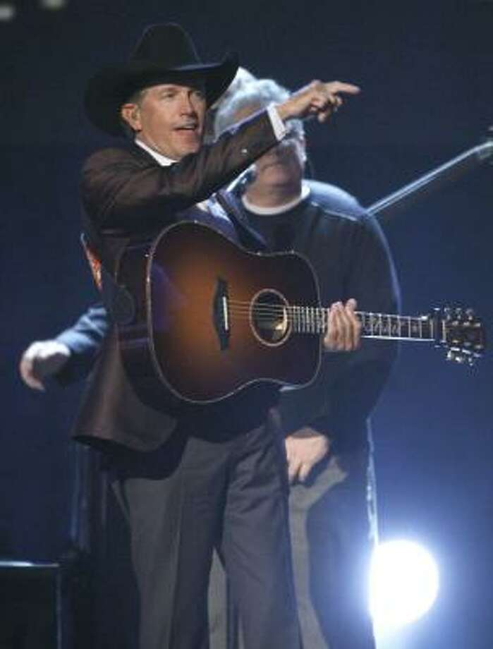 March 17 -- George Strait Photo: Mark Humphrey, AP