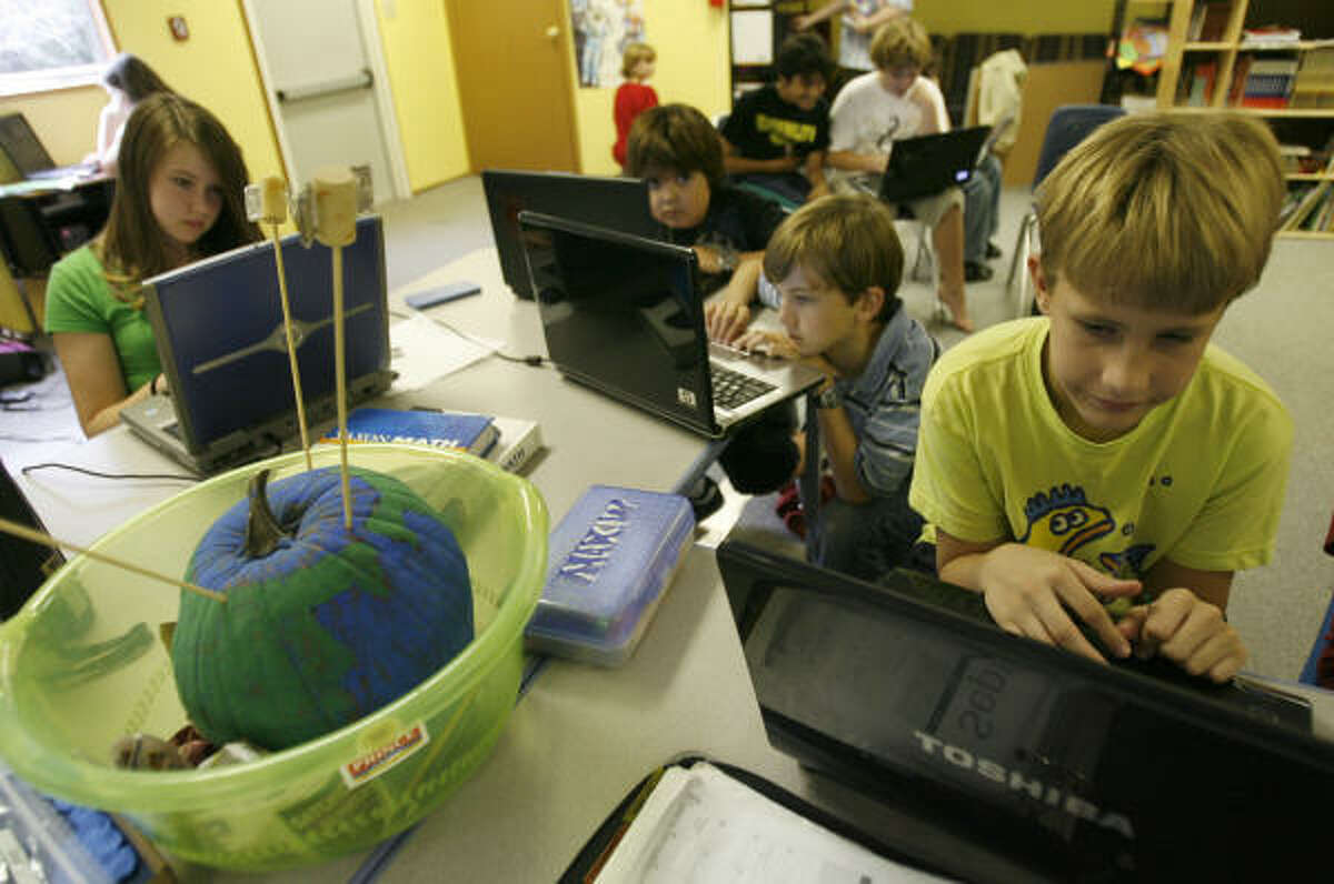 Max White, 12, right, and his fellow students, including Allyson Levine, 12, left, one of just a few females, work on computers at the Rainard School, a non-profit campus for gifted students. Rainard is a small, non-profit private school that serves children with IQs above 135. It has 72 students now, about 75 percent of whom are male.
