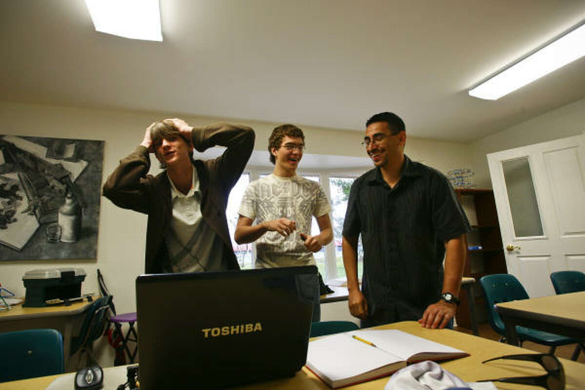 Michael Speller, 17, reacts after getting an algebra problem wrong while classmate, John Heggelund, 16, and teacher Robert Mendez look on at Rainard school, a non-profit campus for gifted students in Houston.
