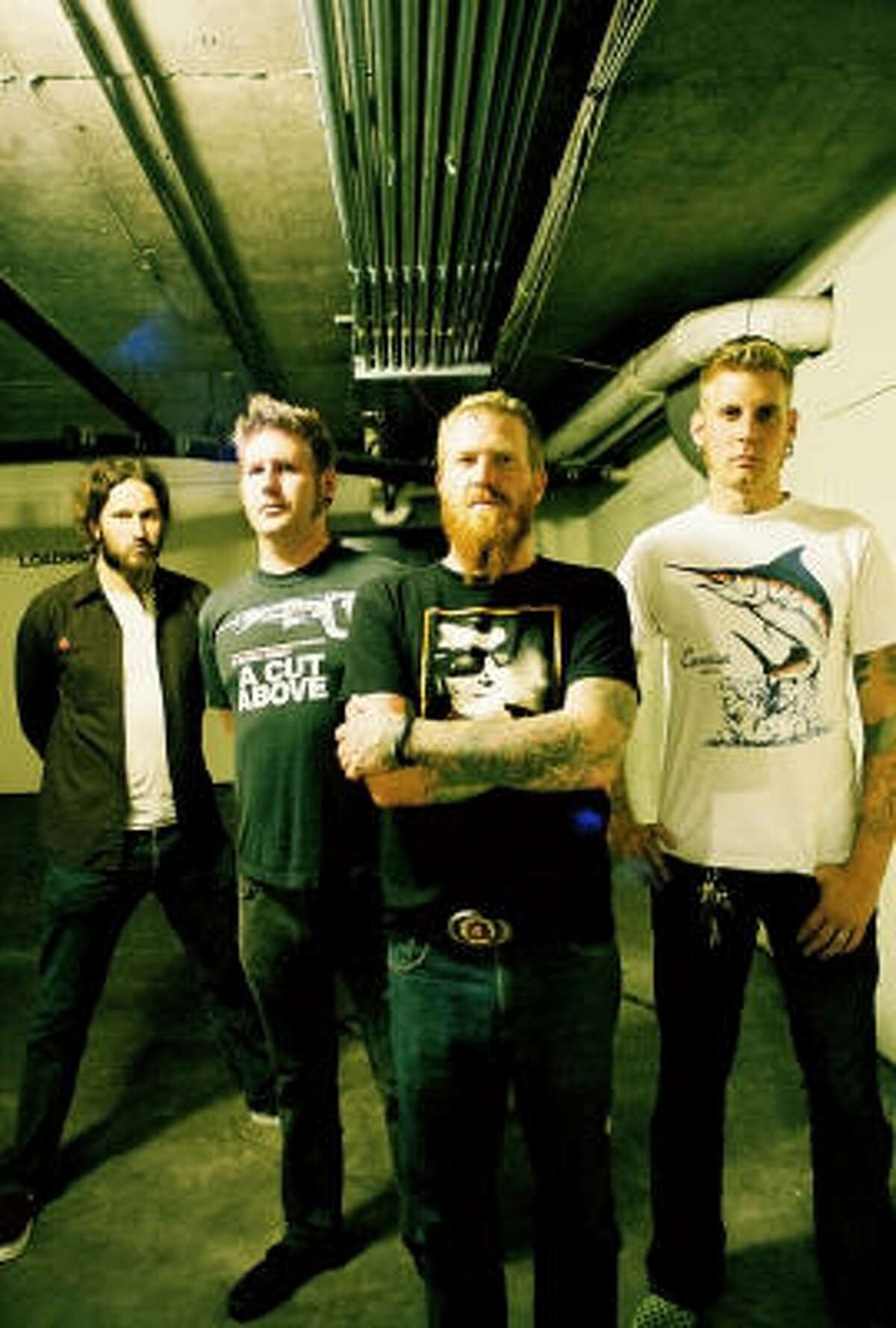 Mastodon's Brent Hinds (center) has a tattoo on his forehead.