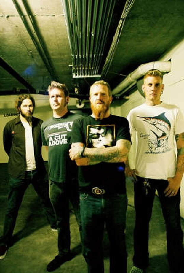 Mastodon's Brent Hinds (center) has a tattoo on his forehead. Photo: Ryan Russell, Warner Bros.