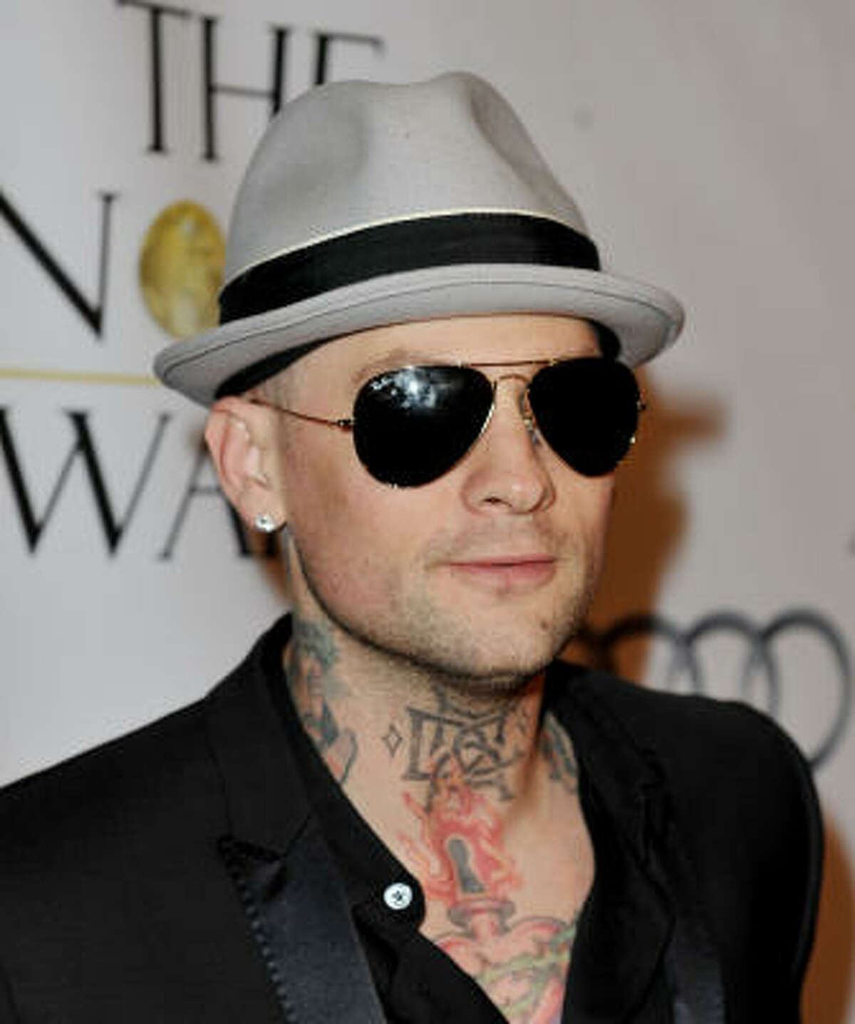 Benji Madden of Good Charlotte and Paris Hilton dating fame has multiple neck tattoos.