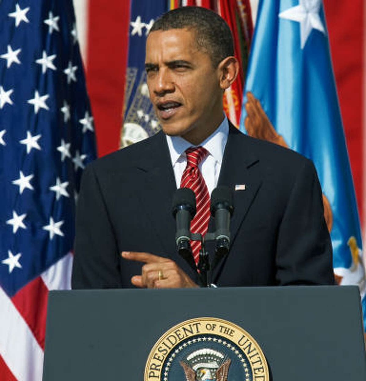 President Obama addresses the crowd at a memorial service for the 13 people killed in a shooting rampage at Fort Hood.
