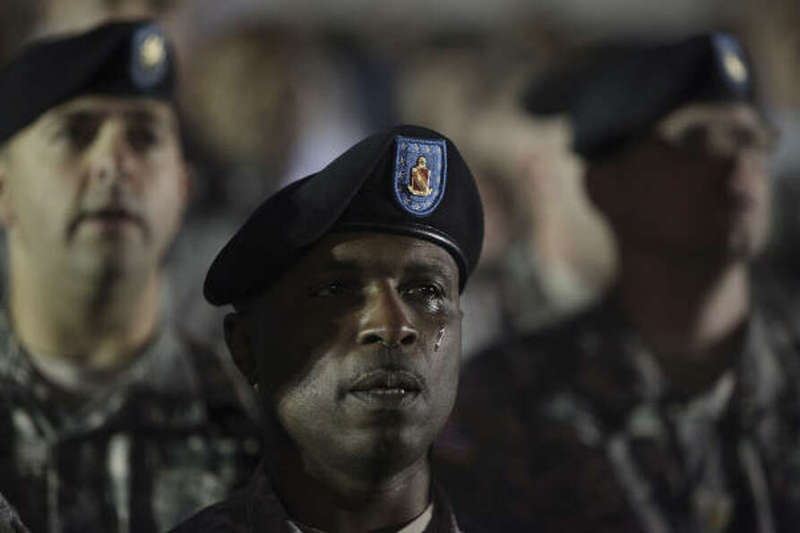 Army Sgt. Maj. Leroy Walker Jr. sheds a tear during a candlelight vigil at Hood Stadium.