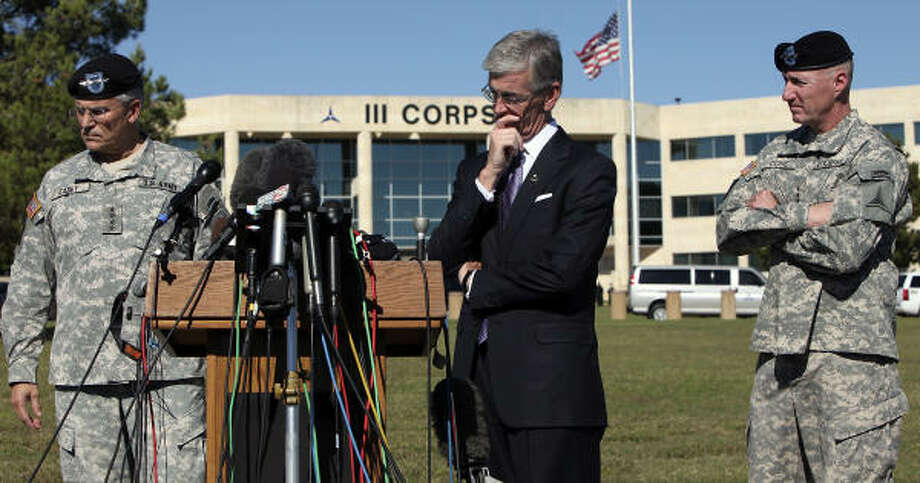 Gen. George W. Casey Jr., the Army's chief of staff, left, Secretary of the Army John McHugh and Lt. Gen. Robert W. Cone talk about the tragedy at a Fort Hood news conference. Photo: EDWARD A. ORNELAS, SAN ANTONIO EXPRESS-NEWS
