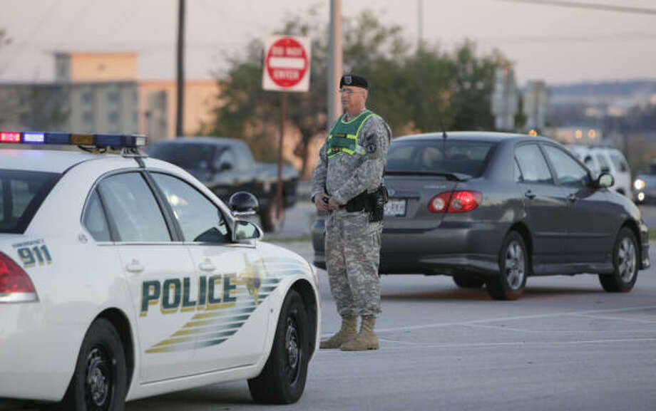 A military police officer stands guard at the entrance of Fort Hood, Texas. Photo: LM Otero, AP