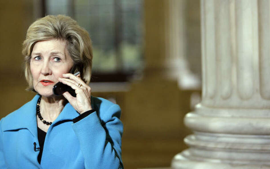 Sen. Kay Bailey Hutchison, R-Texas, talks on the phone about the shooting at Fort Hood, Texas, on Ca