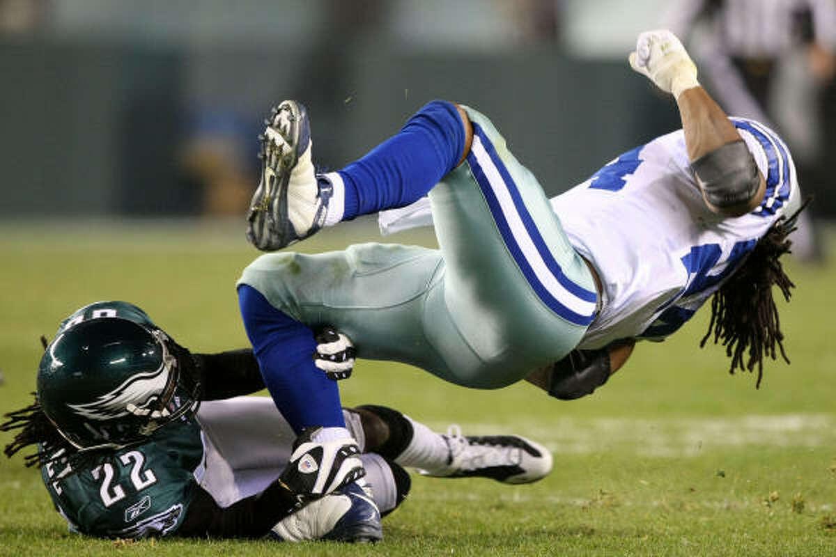 Philadelphia's Asante Samuel (22) takes down Cowboys running back Marion Barber.
