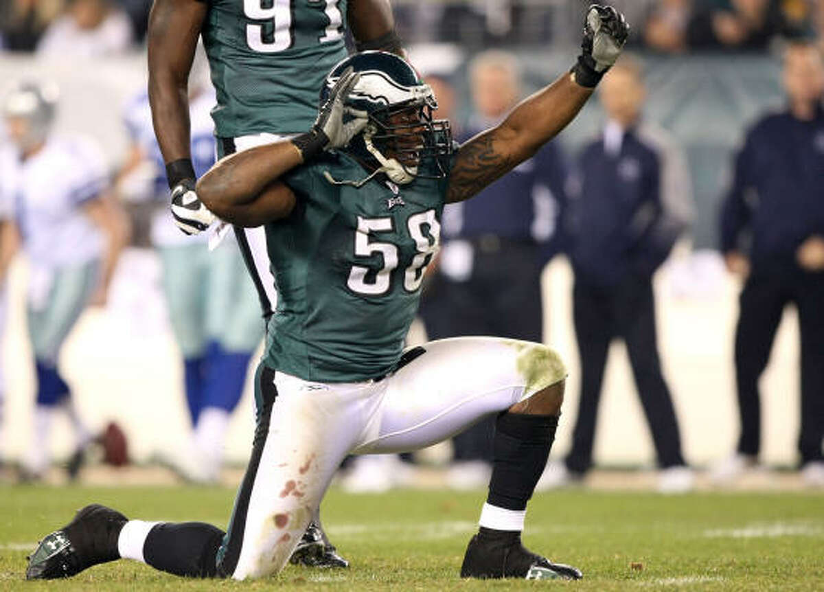 Philadelphia's Trent Cole celebrates after sacking Cowboys quarterback Tony Romo in the third quarter at Lincoln Financial Field.