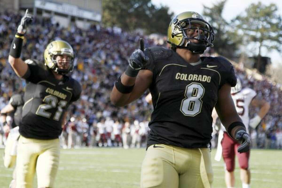 Colorado running back Demetrius Sumler goes in for a touchdown to pull Colorado within three in the fourth quarter. The Buffaloes came back from 10 down in the period to win.