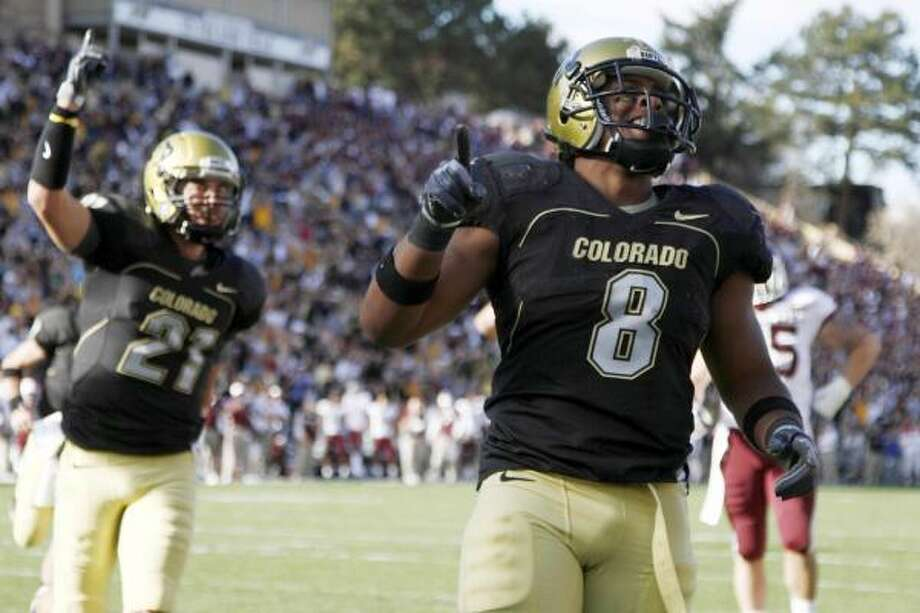 Colorado running back Demetrius Sumler goes in for a touchdown to pull Colorado within three in the fourth quarter. The Buffaloes came back from 10 down in the period to win. Photo: JACK DEMPSEY, AP