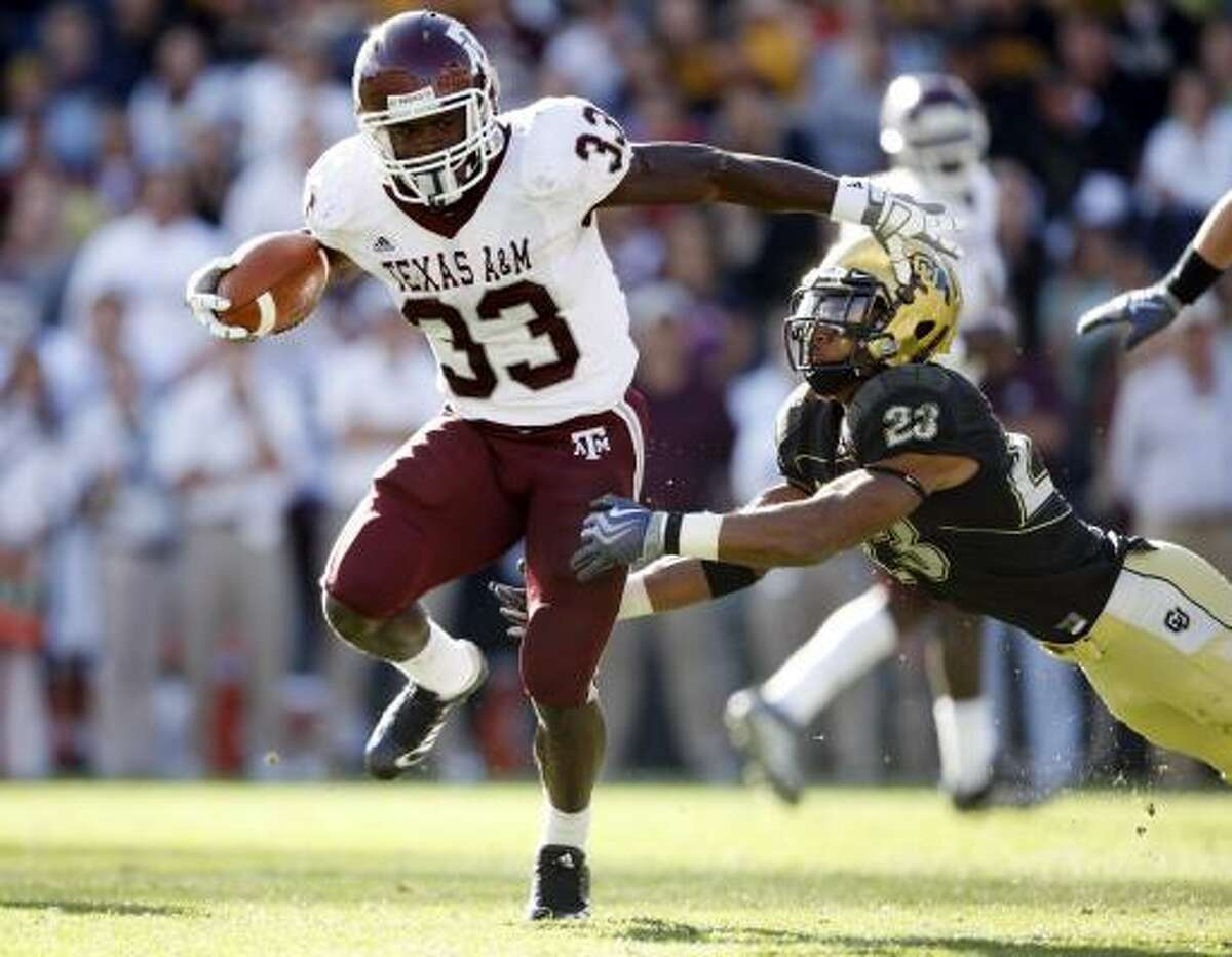 Texas A&M running back Christine Michael, left, breaks a tackle by Colorado cornerback Jalil Brown and runs for a touchdown.