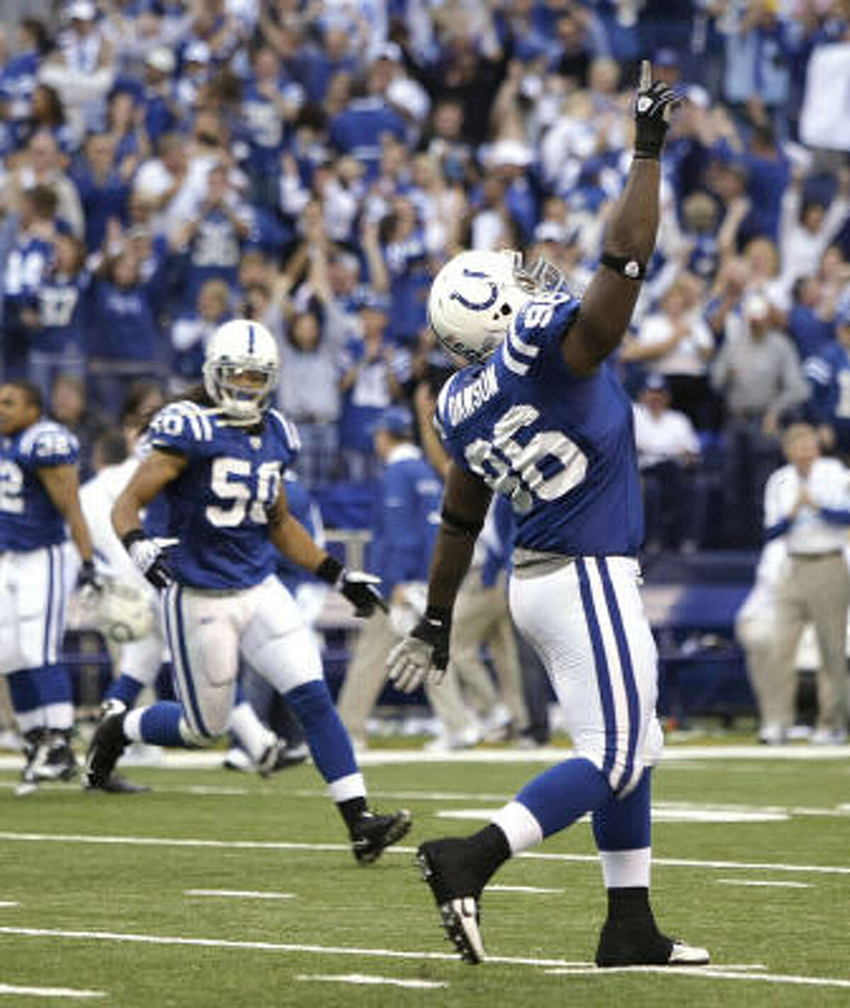 Colts defensive tackle Keyunta Dawson (96) and linebacker Philip Wheeler (50) celebrate the Colts' win over the Texans.