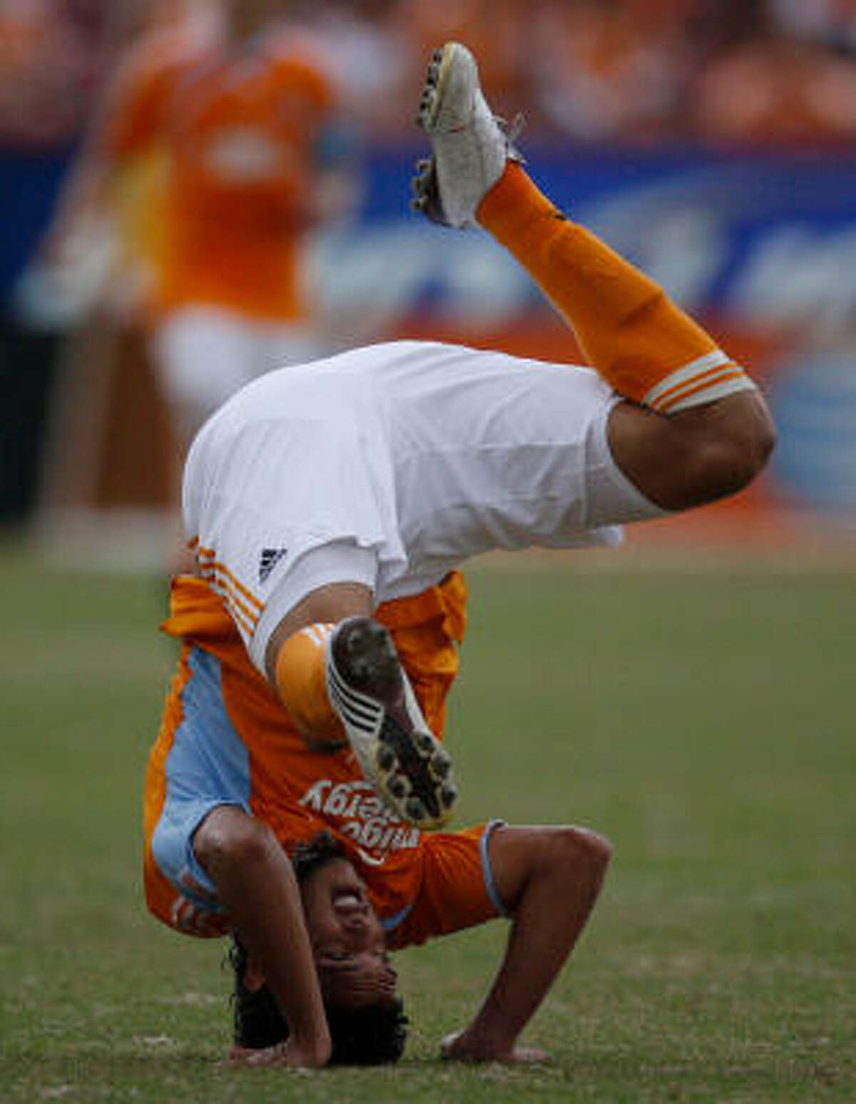 Dynamo forward Luis Angel Landin, who came in as a substitute falls on his head after a collision with Sounders defender Tyrone Marshall.