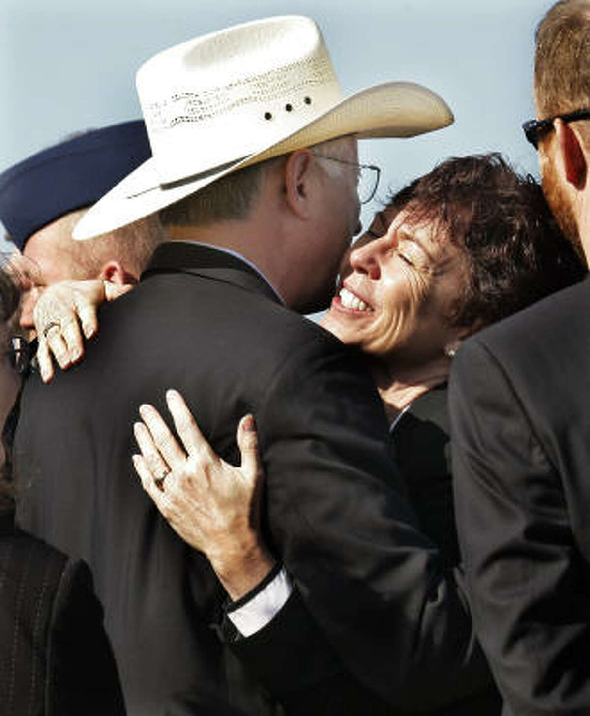 Deborah Borza, mother of Flight 93 passenger Deora Bodley, right, hugs Secretary of the Interior Ken Salazar after the ground breaking for the Flight 93 National Memorial Saturday, Nov. 7, 2009 in Shanksville, Pa..