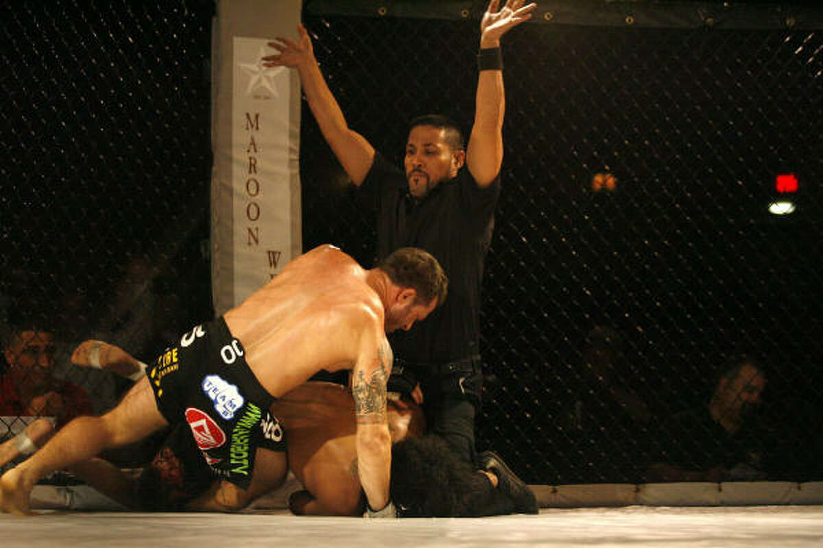 Referee Randy Hauer calls the fight after Chad Robichauz submitted Lewis McKenzie.