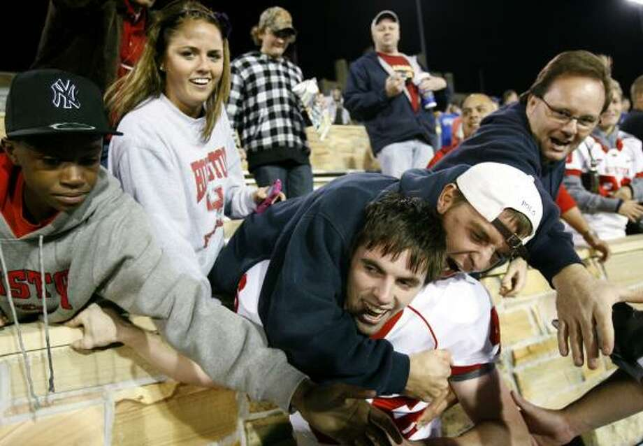 UH kicker Matt Hogan, center, got plenty of love from fans after his game-winning kick beat Tulsa. Photo: David Crenshaw, AP