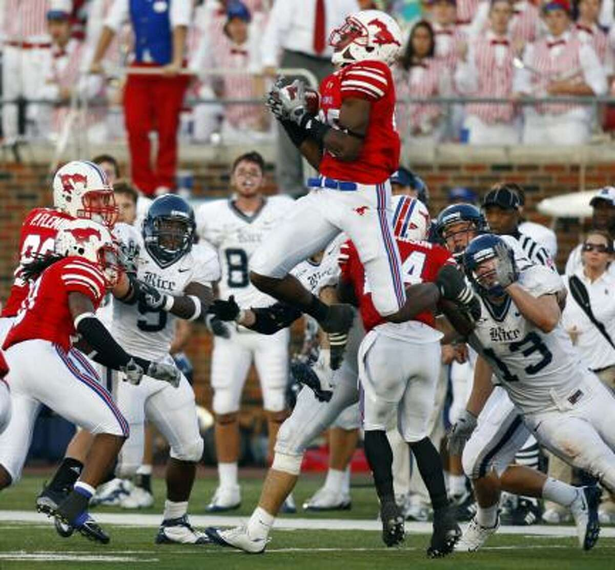 Southern Methodist wide receiver Bradley Haynes (88) grabs a onside kick to secure the win during the fourth quarter Saturday against Rice at Ford Stadium.