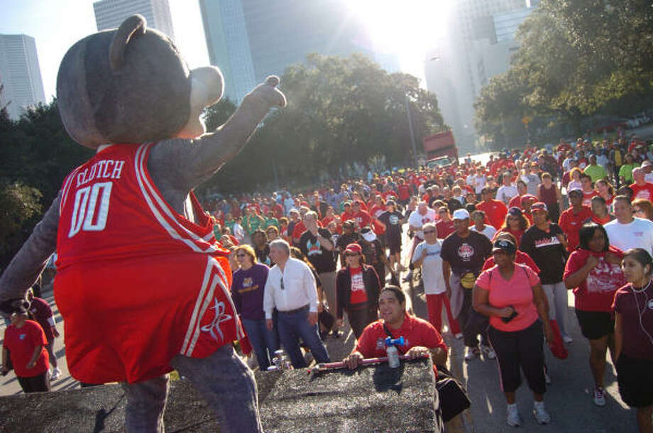 "Houston Rockets' Mascot, Clutch, gets around 15,000 ready to walk in the Houston Heart Walk put on by the American Heart Association Houston Division in downtown Houston. Communications Director for American Heart Association Houston Office Tiffany Travis said they were able to raise $1.5 million to support research for stroke and heart disease. ""But the overall message"", said Travis ""is to lead healthy lives by walking 365 days a year"". Photo: Chris Curry, For The Chronicle"