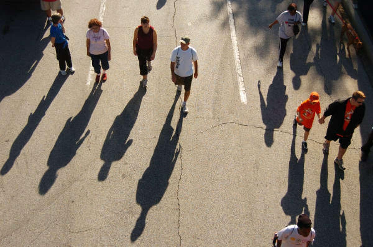 Walkers walk down Allen Parkway in the Houston Heart Walk.