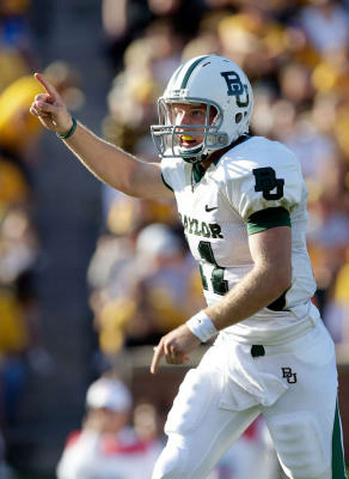 Baylor quarterback Nick Florence reacts after throwing for a touchdown against Missouri during Saturday's game in Columbia, Missouri.
