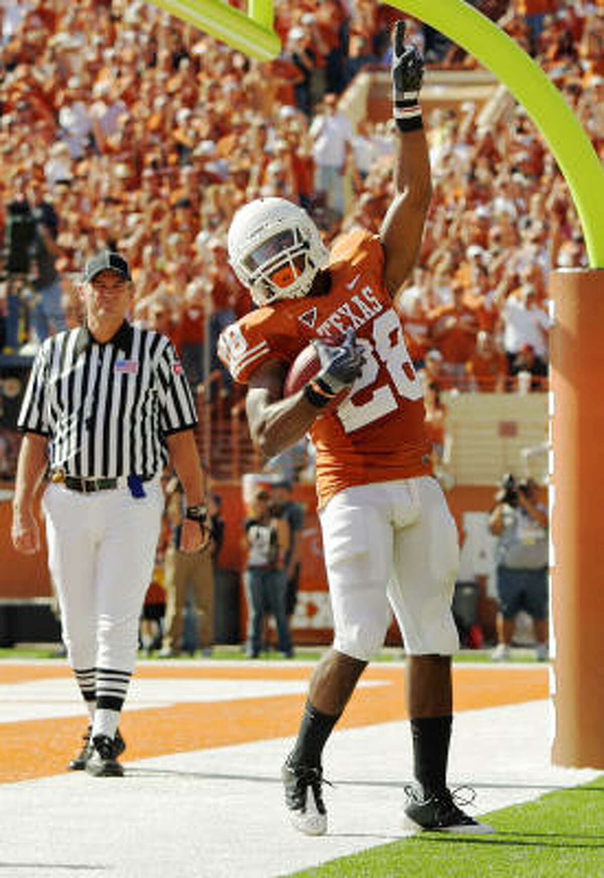 UT running back Fozzy Whittaker celebrates a touchdown during Texas' victory against Central Florida on Saturday in Austin.