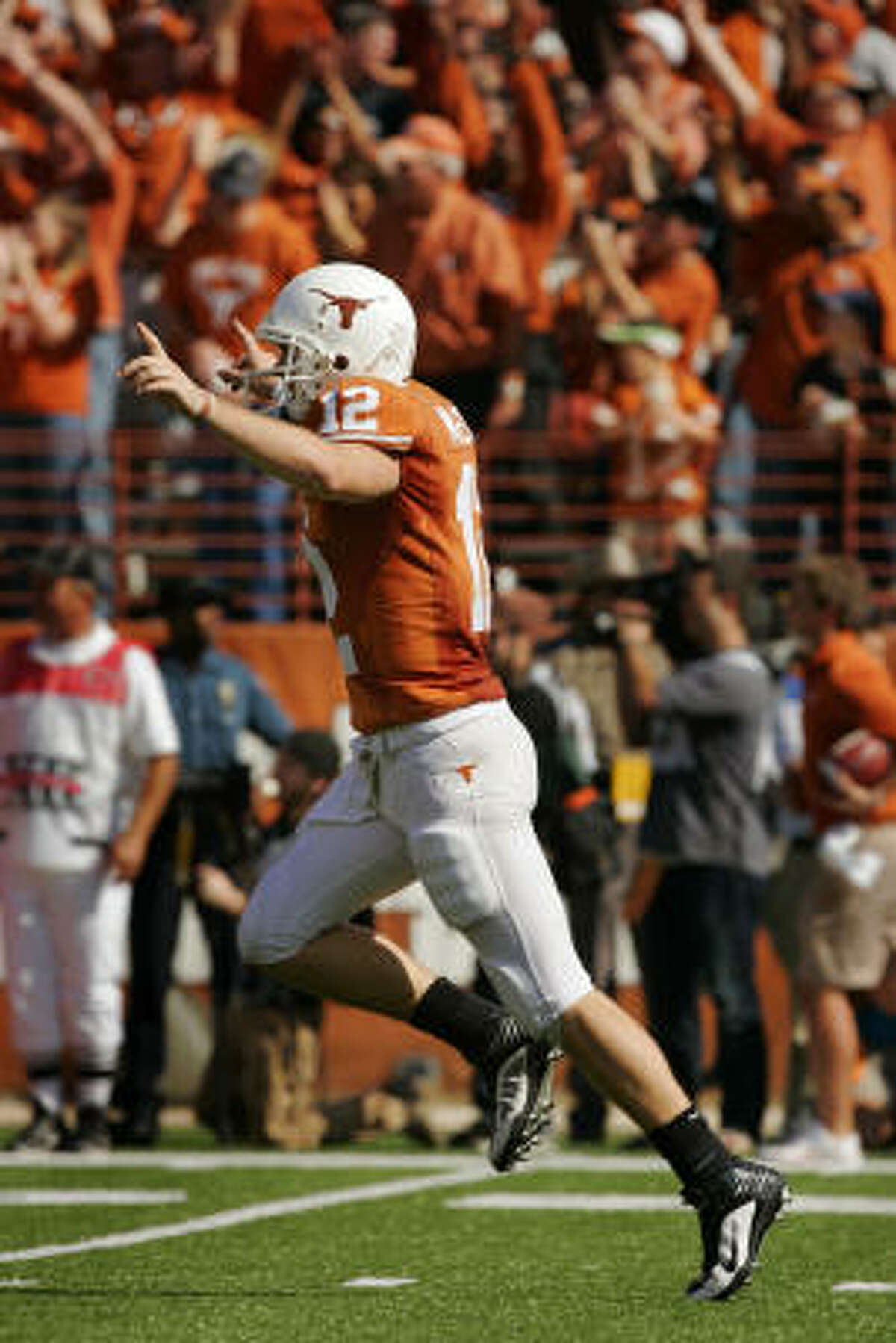 UT quarterback Colt McCoy celebrates after throwing a touchdown pass to wide receiver Jordan Shipley.