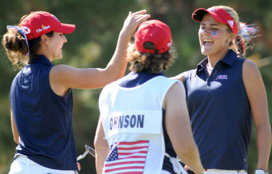 Alexis Thompson, right, and teammate Jennifer Johnson were all smiles after shooting a 66 in the third round of the Spirit International Amateur Golf Championship on Friday at Whispering Pines Golf Club in Trinity. Photo: Jerry Baker, For The Chronicle