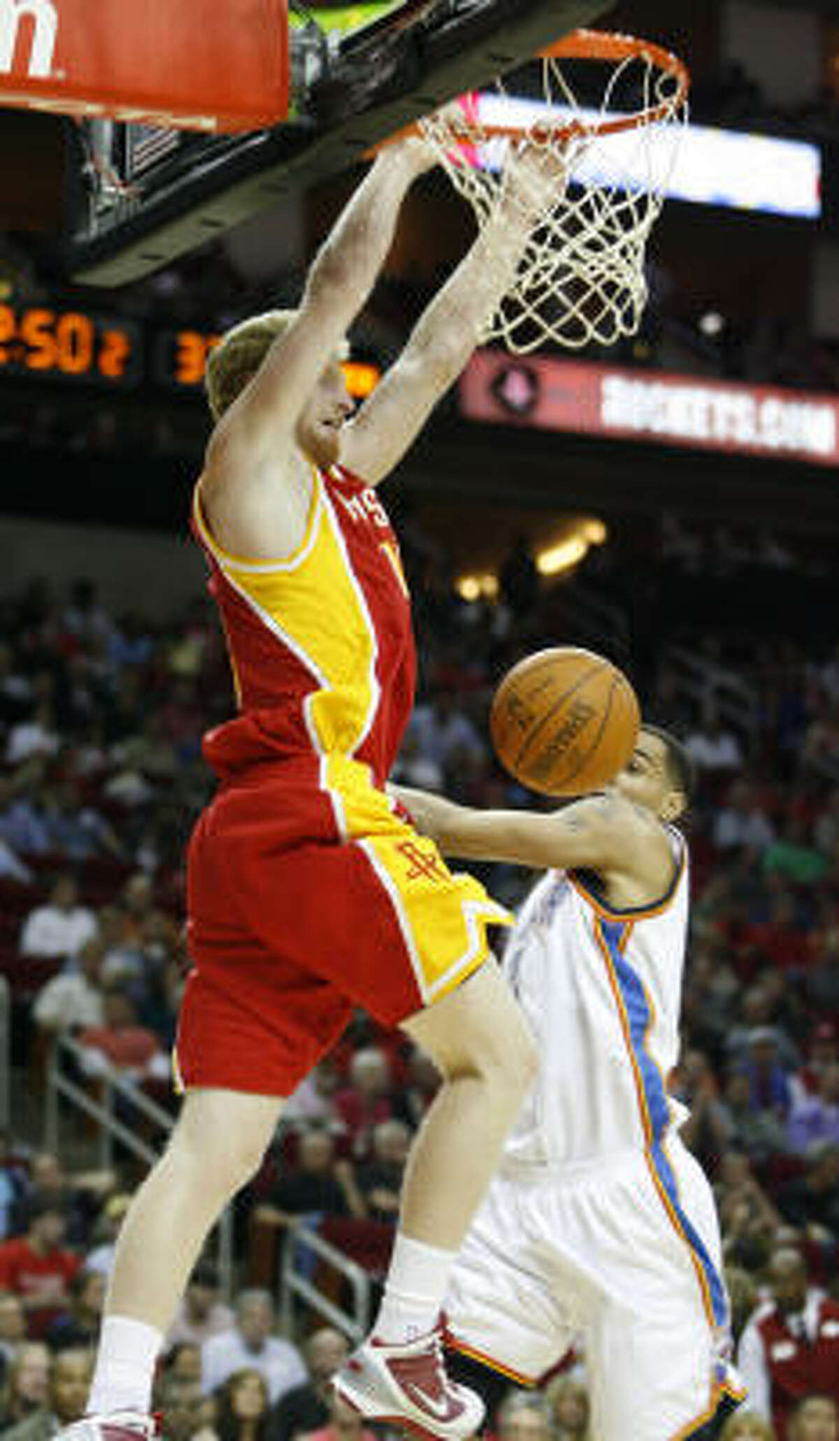 Rockets forward Chase Budinger slams home a dunk in the first of Friday's game against the Oklahoma City Thunder at Toyota Center. Budinger scored 16 points off the bench to help the Rockets defeat the Thunder, 105-94.