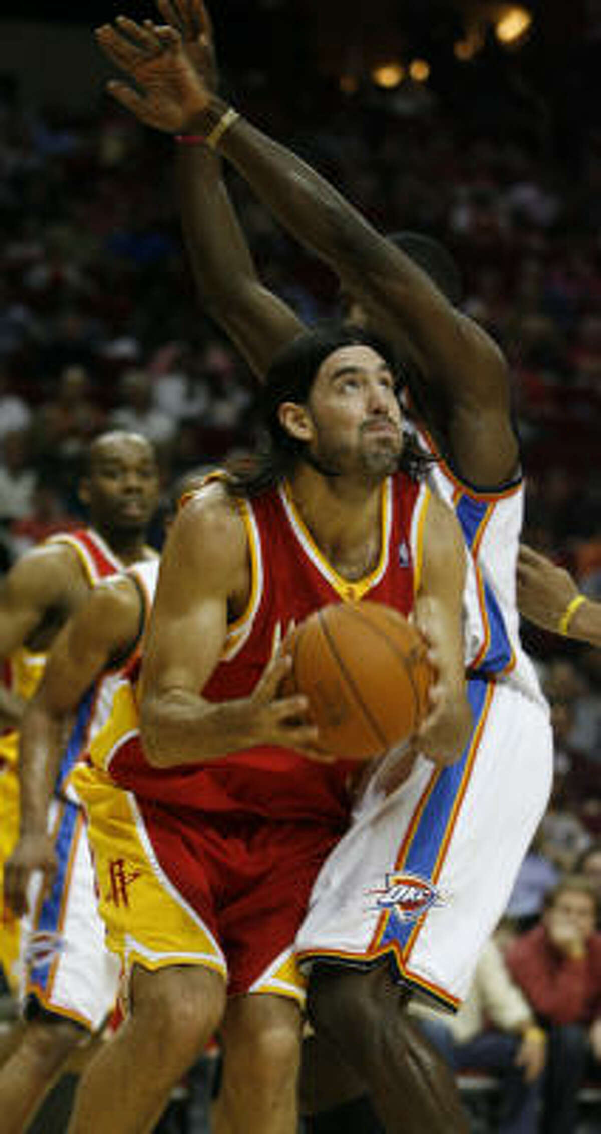 Houston's Luis Scola, left, drives to the basket against Thunder forward Kevin Durant.