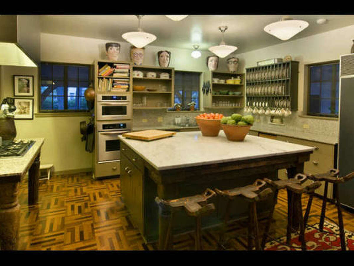 The European-style kitchen showcases a center island with informal seating.